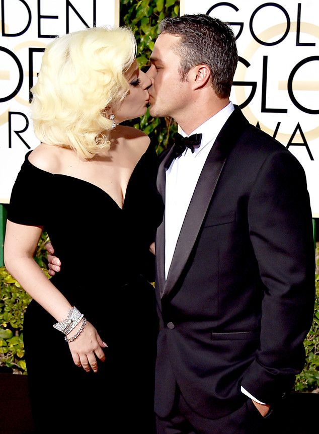 73rd Annual Golden Globe Awards - Lady Gaga WON an award for her role in The American Horror Story: Hotel as Best Actress in a Limited Series or TV Motion Picture. She is pictured smooching with her fiance, actor Taylor Kinney of Chicago Fire TV series on January 10, 2016 at the ceremony.