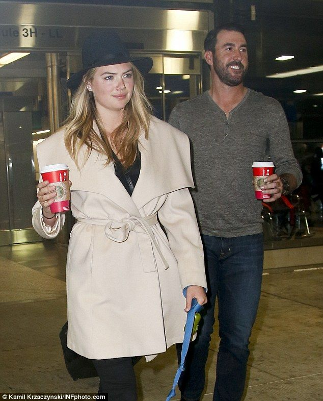 Jetset trio: Kate Upton was spotted leaving Chicago's O'Hare airport with her precious Box...