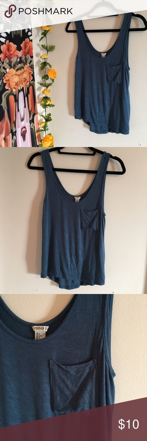 "💥Forever 21💥 Softest Blue Tank Quite literally the softest thing I have ever felt, this tank top is a great staple piece for any wardrobe!  Type: Tanktop Brand/Store: Forever 21 Size: L Defects: None  💀🖤LO'S SHOP🖤💀 💥I'm always accepting offers through the ""Offer"" button 💥15% off on 3+ items bundle 💥All items are sold as-is, and any issues will be called out above 💥Please feel free to ask any questions you may have in the comments  🖤HAPPY POSHING🖤 Forever 21 Tops Tank Tops"
