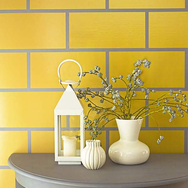 yellow wall painted to mimic classic subway tiles style, march 2014 color of the month pantone freesia