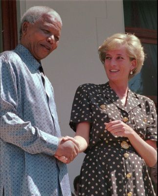 South African President Nelson Mandela, left, shakes hands with Princess Diana in Cape Town, Monday, March 17 1997. Princess Diana met with Mandela to discuss the threat of AIDS in South Africa. (AP PHOTO/Sasa Kralj)