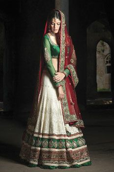 Georgette lucknowi bridal ghagra along with dupion silk blouse and contrast net dupatta. Embellished with zardosi, resham, sequins and stone work.