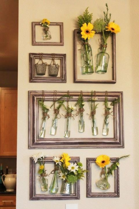 Fill your walls with fresh flowers by hanging jars inside revitalized old picture frames to make a uniformed collage.
