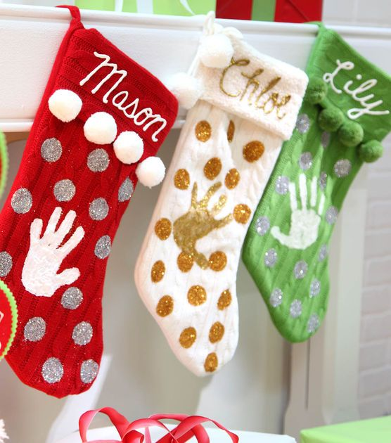 Sweet monogram and child's handprint Christmas stockings.  What a fabulous keepsake and so easy!!!  Tutorial by Joann.com