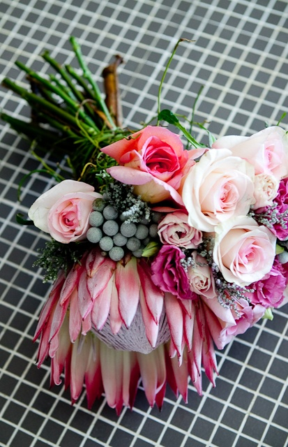 The King Protea Bouquet    King Protea with draping display of silver brunia, roses and slangbos   ASPEN FLOWERS  CO   Photo Credit   Monica Dart Photography