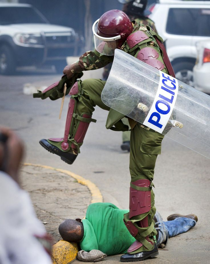 A Kenyan riot police officer stomps on a protester in downtown Nairobi on May 16. Kenyan police have teargassed and beaten opposition supporters demanding the disbandment of the electoral authority over alleged bias and corruption. The 46 Most Powerful Photos Of 2016