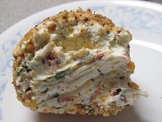 2 (8 oz) cream cheese; 1 (1 oz) packet dry buttermilk ranch dressing mix, 1/2 cup grated cheddar cheese; 4 green onions (thinly sliced); 5 pieces of bacon (fried and crumbled) * mix cream cheese and ranch seasoning together until smooth; add cheddar cheese, onions and bacon; stir until well combined; shape into a ball; roll in chopped nuts for coating; store in refrigerator