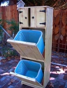 Love the idea of a hidden laundry hamper.