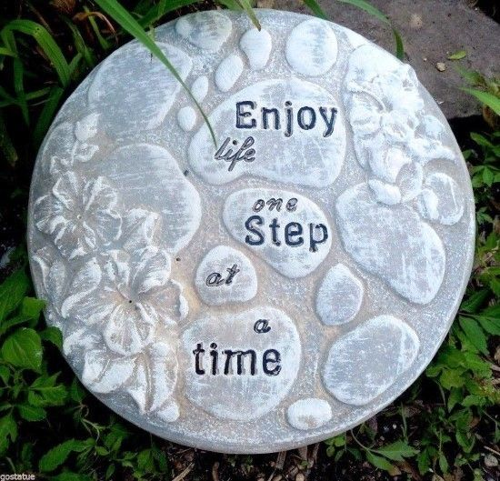 Message on the Path: Enjoy Life One Step at a Time. DIY this from a mold that is pre-made and ready for concrete.  If you are making only one or two stepping stones this is a quick and easy way to go. If you plan to make a pathway, there are some other ideas here for making a lot of pavers inexpensively.