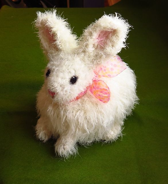 This crochet bunny looks real! Make it with Lion Brand Romance and Vanna's Choice - the perfect addition to your handmade Easter Basket! Get the free crochet pattern by craftdesignerforhire now.