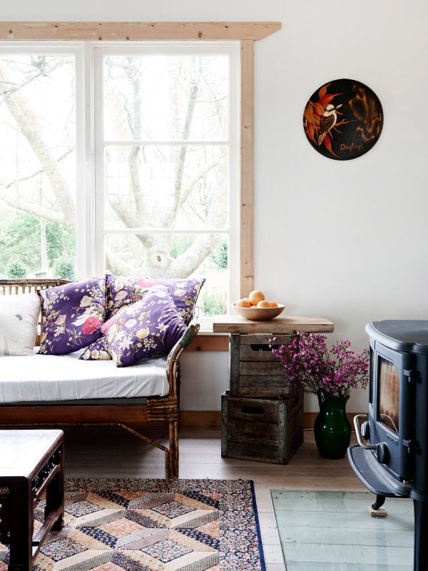 Crate side table with butcher block top.  Quilt rug.  I love the unexpected & homespun feel of this room.