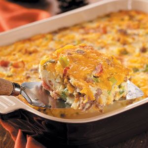 Holiday Brunch Casserole Recipe from Taste of Home -- If you'll be having overnight company during the holidays, you may want to consider this hearty casserole.  —Nelda Cronbaugh, Belle Plaine, Iowa
