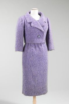 Ensemble Design House: House of Givenchy (French, founded 1952) Designer: Hubert de Givenchy (French, born Beauvais, 1927) Designer: Textile by Ascher (British) Date: 1958 Culture: French Medium: wool Dimensions: Length at CB (a): 40 in. (101.6 cm) Length at CB (b): 18 1/2 in. (47 cm) Credit Line: Brooklyn Museum Costume Collection at The Metropolitan Museum of Art