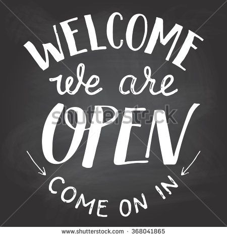 Welcome we are open. A welcome sign for cafes or shop visitors on blackboard background with chalk. Hand lettering - stock vector