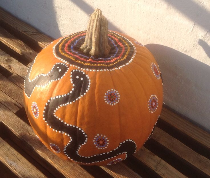 Pumpkin decorated with acrylic paint and a black permanent marker.