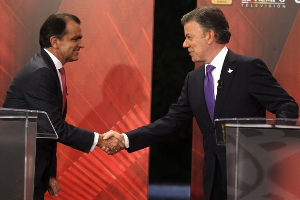 Colombia elections 2014: Juan Manuel Santos and Oscar Ivan Zuluaga face runoff poll