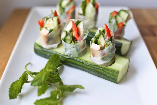 ... , bell pepper, avocado, tofu and daikon held in a cucumber bed