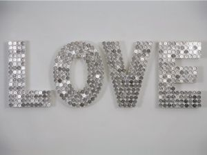 "Use pennies, spray paint silver - ""love"" this."