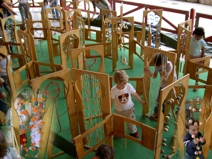 labyrinthe petite enfance  A maze for small children that has sensory and auditory stimuli as you wander through the arches.