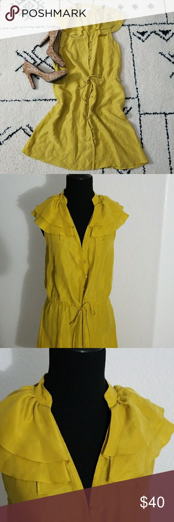 Anne Taylor Loft 100% silk Anne Taylor Loft has a  ruffled V neckline. Color is a saffron /gold . Dress is Racerback.  Hook button closure with tie at waist. 1st top 5 buttons have a glue like dots, a material flaw shown in pic #5. Ann Taylor Dresses