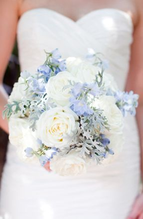 I like big ivory flowers with dusty blue accent.