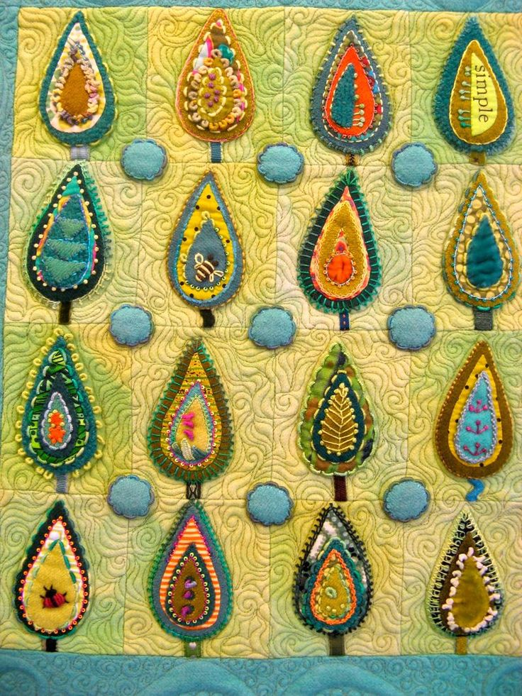 An array of stitches by Sue Spargo, leaf sampler with wool applique, in a class held at Precious Time (Australia)