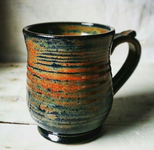 Ceramic mug thrown on the wheel, bisque fired to cone 06 and glaze fired cone 6. Three coats of Amaco ironstone glaze.