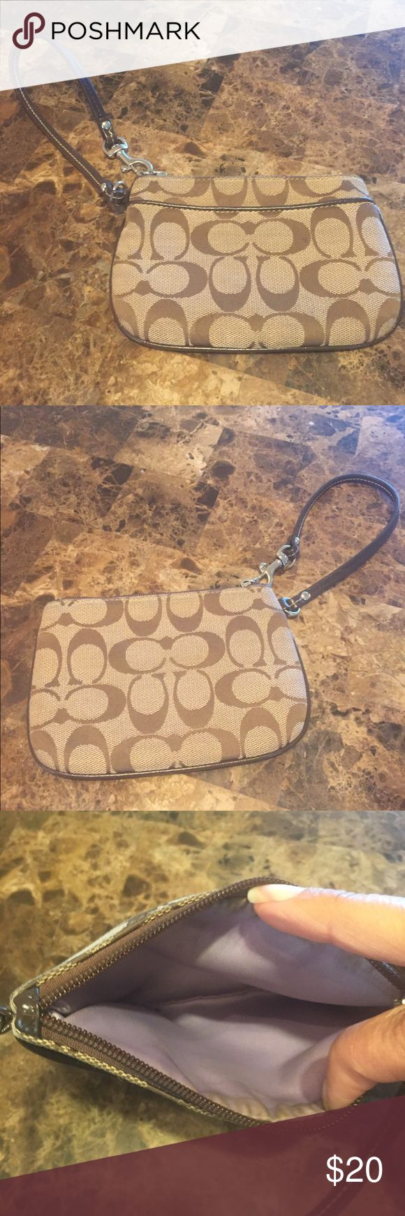 Coach wristlet Coach wristlet in good condition exterior is still nice the interior is purple and a bit dirty from the top edges Coach Bags Clutches & Wristlets
