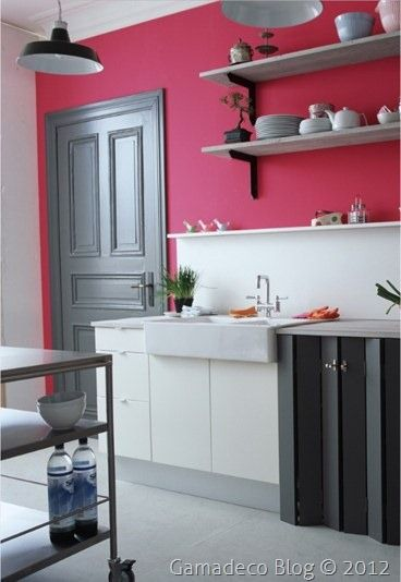 Small kitchen with brink pink wall and lots of white & grey