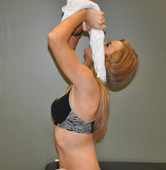 Cervical extension w/ traction Wrap a thin towel/t-shirt around the base of your head. Keep your hands even with your eyes as you extend your head back as far as is comfortable. Pull with your arms to maintain light pressure on the back of your head. Perform 15 repetitions.