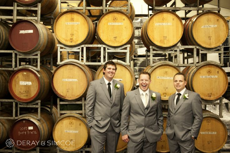 Groom and groomsmen in front of wine barrels. Rustic wedding reception styling, ideas and inspiration. Reception Venue: Sittella Winery, Swan Valley WA Photography by DeRay & Simcoe