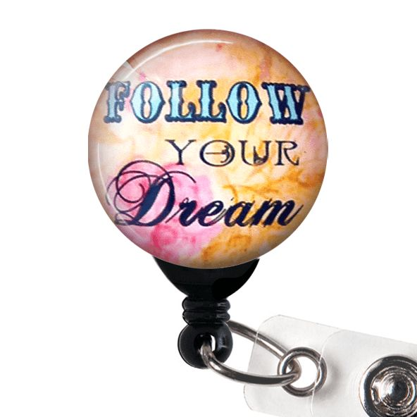 "This ID badge reel features an inspirational saying ""Follow Your Dream"" under a photo glass dome. The glass dome magnifies the design providing clarity and beauty. ID Badge reels are stylish and pract"