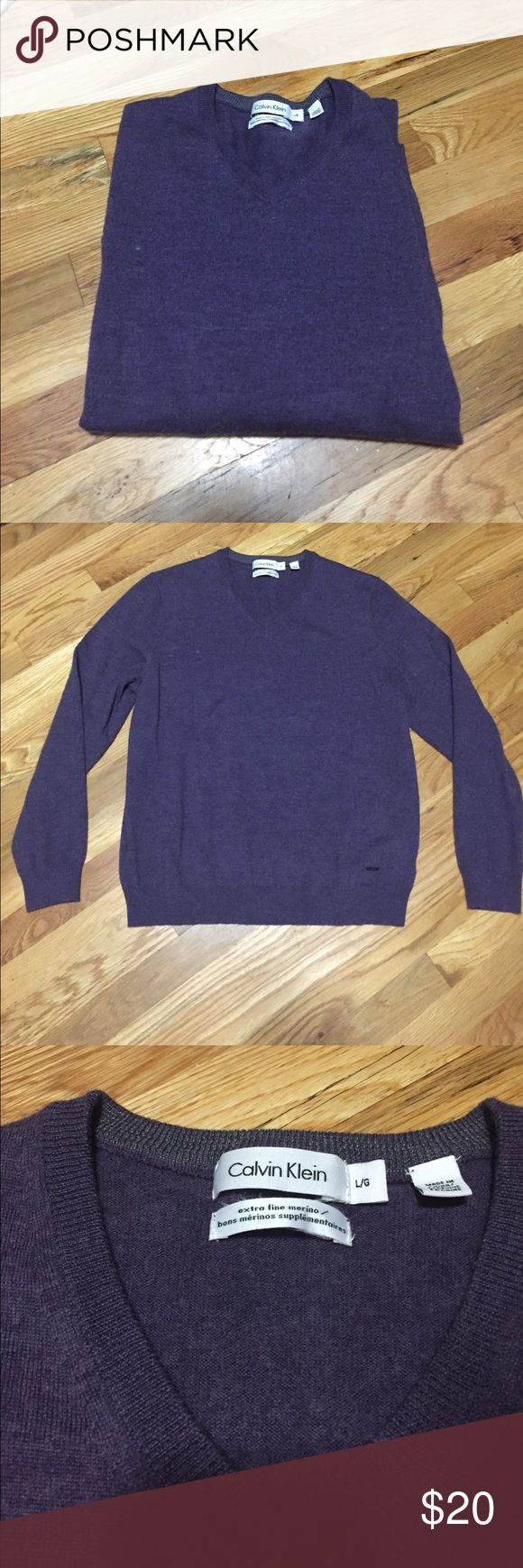 """Calvin Klein Extra fine Merino Vneck Sweater men L Great condition, extra fine wool v neck sweater. There is a white dot by the neck (photographed) that is not a stain but in the fabric. Sweater length: 25"""" shoulders: 17"""" sleeve length: 24"""" Calvin Klein Sweaters V-Neck"""