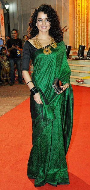 Ditching her trademark Dior bag and couture gowns, Kangna downplays the skin show but manages to stun nonetheless. Emerald green is her colour.