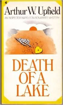 """""""Death Of A Lake"""", one of Arthur W, Upfield's very best """"Bony"""" novels set in the Outback.  The star of this novel is a slowly-dying lake,  for which a group of people on a remote ranch are waiting for the lake to give up its deadly secret."""