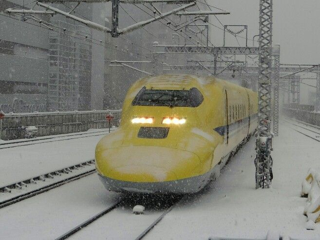 """Doctor Yellow"" in snow. This is special train for inspecting Shinkansen train tracks.. Because of it does not run very frequently, it some times said, you would have a good fortune, if you can watch him!! (Shinyokohama, Kanagawa Japan)"