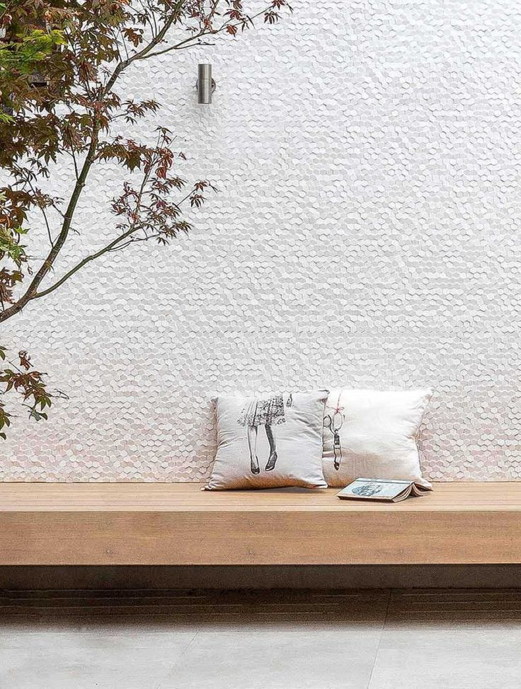 Outdoor kitchen white tiled wall in a remodeled house in Sydney by Benn + Penna Architecture | Remodelista