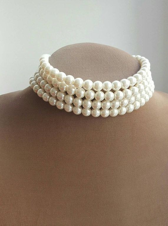 Ivory Swarovski multilayer pearl choker necklace, pearl choker neckace,14 inch necklace,multistrand pearl choker,princess diana pearl choker I used 8 mm superbe quality glass pearls for this beautiful choker. It has four layers of perfect pearls, comparable in beauty to real pearls. They have similar shine and weight. The total lenght is 14 inches and it has an extension chain. But if you need it shorter or longer, please let me know, I can adjust the lenght. Its a classic style, which has…