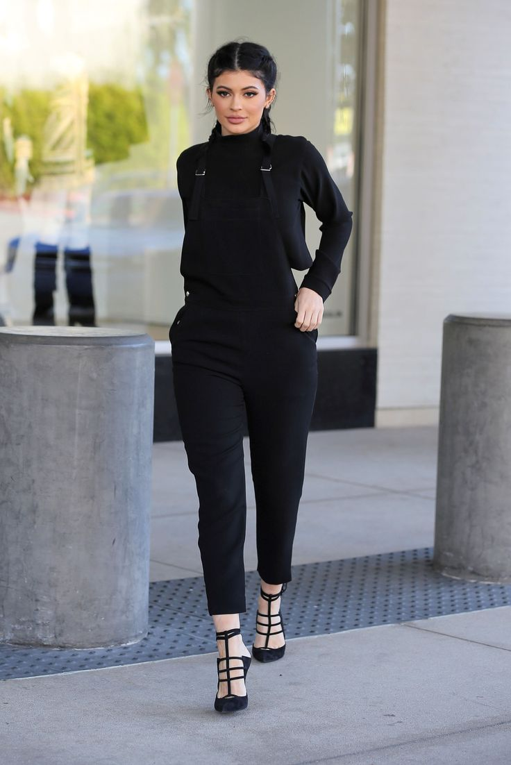 Kylie Jenner wears an all-black ensemble with black strappy heels