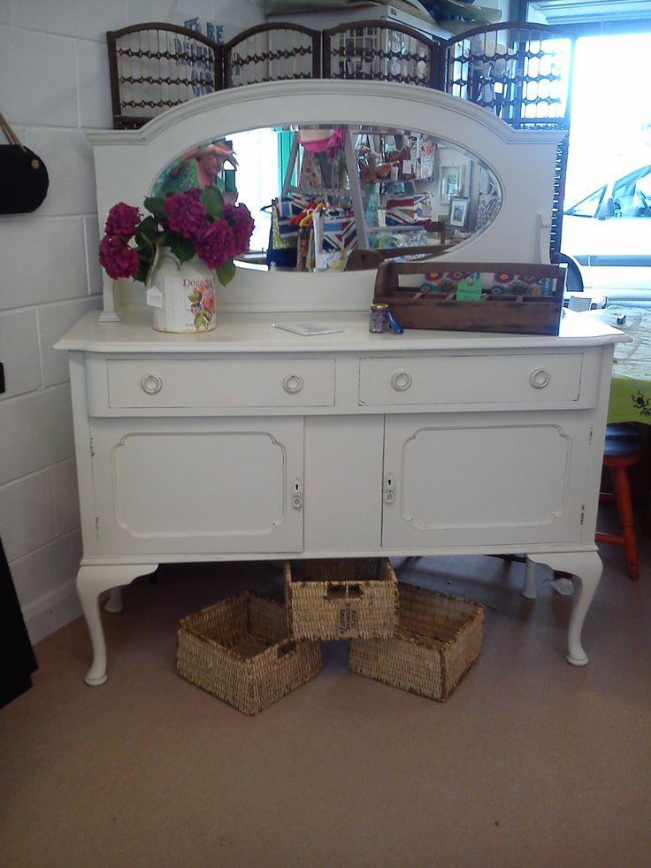 White dresser, painted dark pink inside.