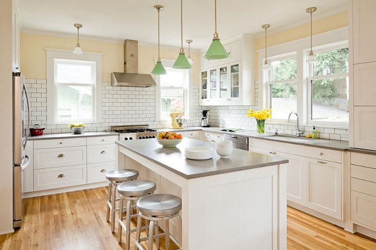 Love the bright big kitchen. Is the counter stainless?  Digging the subway tile.