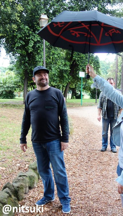 Mark Sheppard looking suspiciously at a devils trap umbrella...genius!
