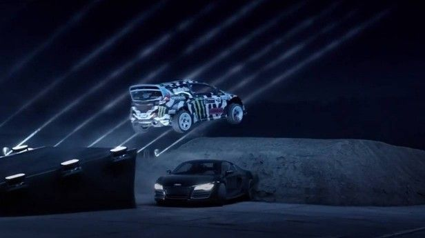 Ken Block jumps a Audi R8. Why? Because he can.  http://www.autorevue.at/motorblog/ken-block-audi-r8-castrol-blackout-mike-rockenfeller-bmw-z4-laser-lamborghini-aventador.html