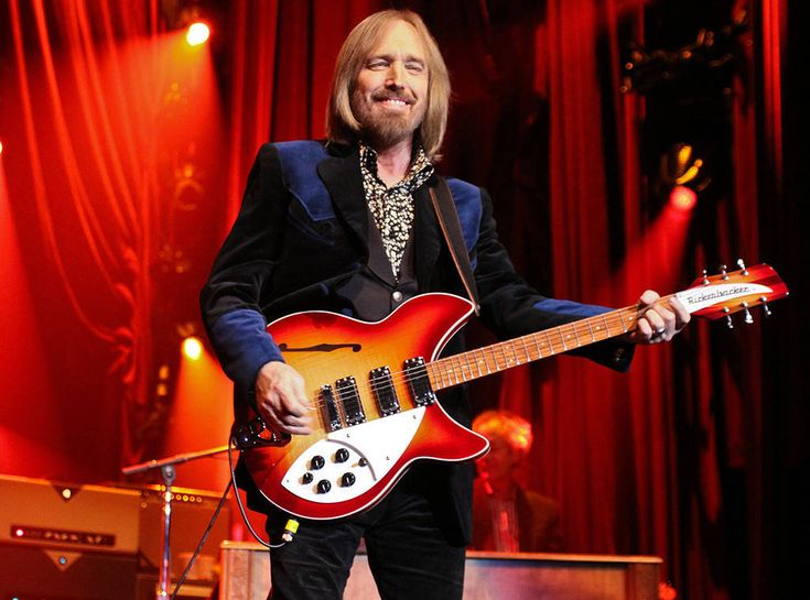 All Smiles, All the Time from Tom Petty: A Life in Pictures Petty looked happy as can be while performing in Colorado in 2012.