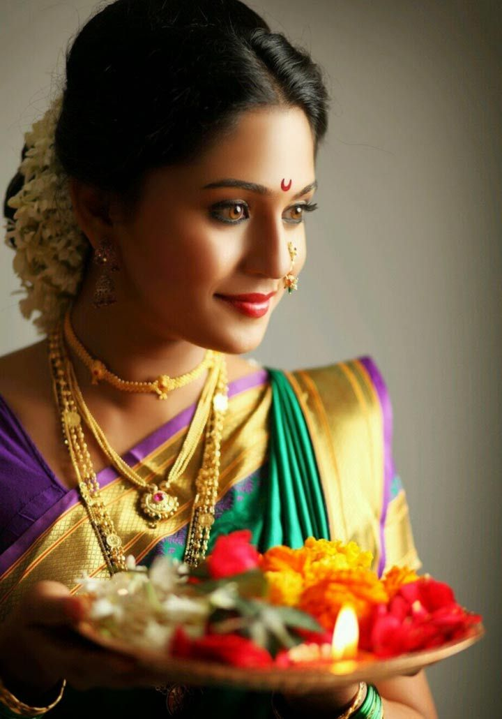 The Maharashtrian bride is one of the many beautiful brides coming from the subcultures in India. Like any set of practices that follow their own process for a wedding ceremony, the Marathi bride is also a unique creation in terms of pure aesthetics – the nauvari saree, the half-moon motif along with a bindi on the forehead adorned by the mundavalya.