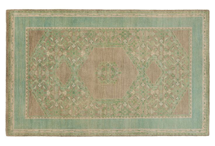 Rendered in stunning hues of neutral and green and masterfully hand-knotted of wool, this traditional rug will add depth and dimension to any space.  A rug pad is recommended to keep it securely in...
