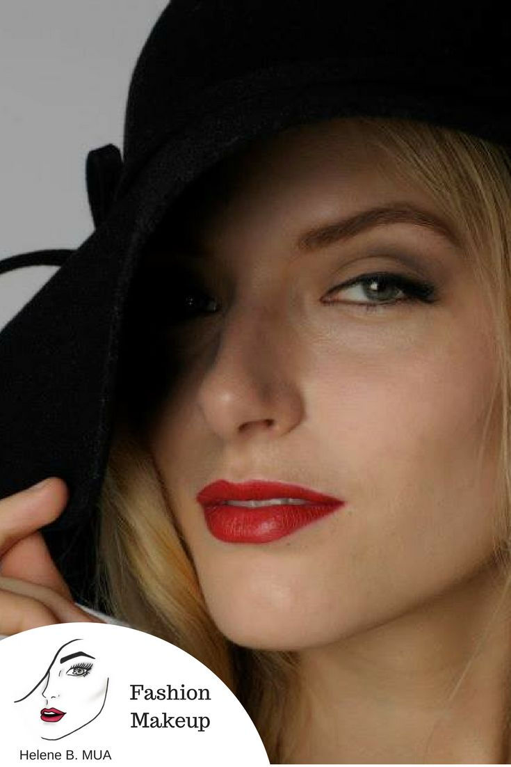 Classic Beauty Makeup. Red Lip, soft black wing liner, natural eyeshadow. Professional Model.