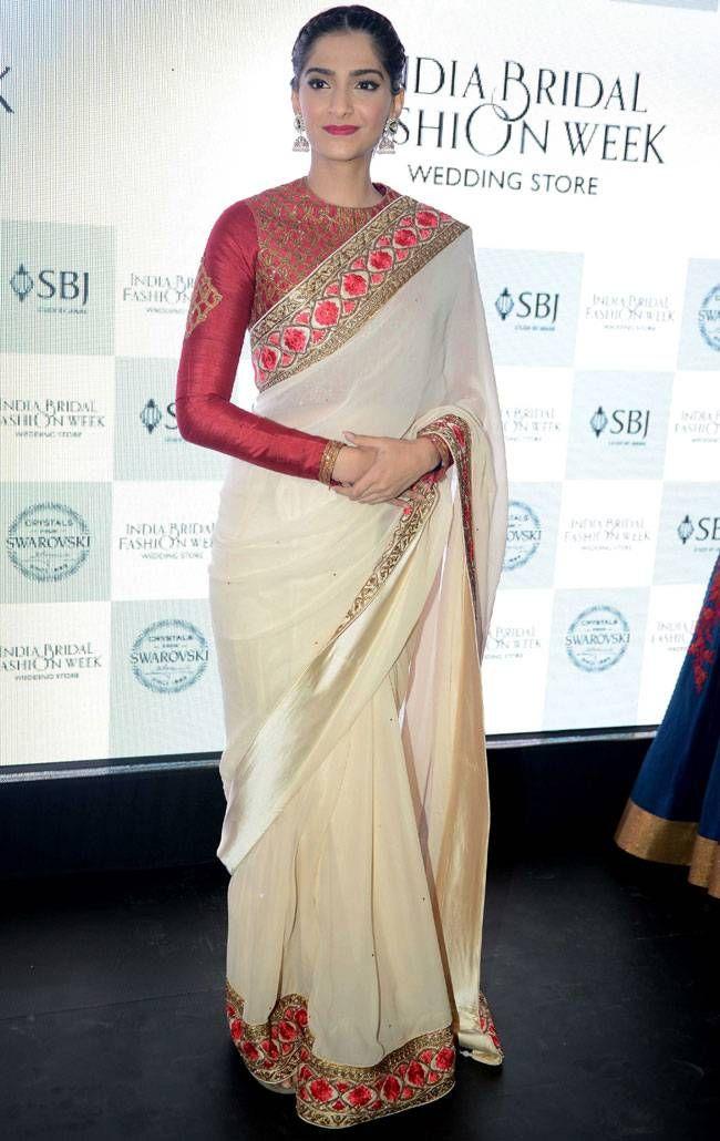 Sonam in beautiful beige with red sari :)