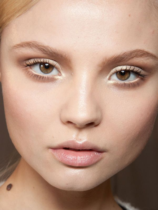 """Christian Dior Fall 2012...""""Pat McGrath used gold shimmer on the tops of the cheekbones and eyelids; brow shadow to define the eyes; tons of mascara; beige pencil on the waterlines, and just clear balm on the lips."""""""