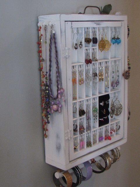 Hanging Jewelry Organizer Display with two layers of storage by BlackForestCottage on Etsy https://www.etsy.com/listing/129551104/hanging-jewelry-organizer-display-with
